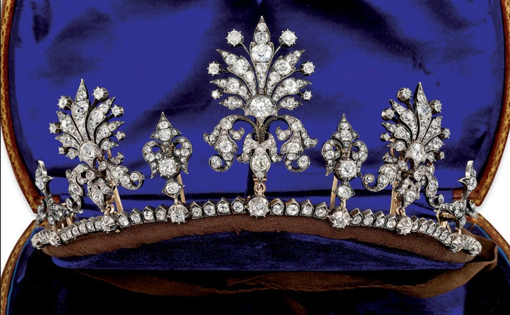 VICTORIAN DIAMOND TIARA/NECKLACE  Composed of three graduated stylised palmette design panels, each entirely set with old-cut diamonds, interspersed by similarly-set fleur-de-lys motifs, raised on a diamond line border, mounted in silver and gold, circa 1860, 5.8cm high, together with fittings for brooches, hair pins, hat pins, earrings and a necklace, fitted case.  See also off-the-frame board.  Image Christies