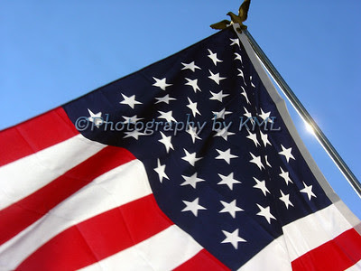 american flag against a blue sky