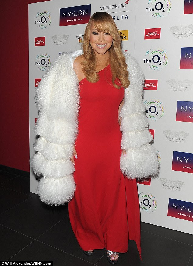 Xmas queen: Mariah entered the NY-LON Lounge Bar while bundled in an ivory faux fur coat - evoking her 1994 hit song All I Want For Christmas is You