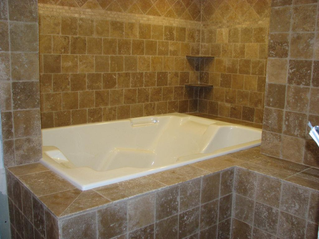 travertine tile jacuzzi from Pepe Tile Installation in Westville