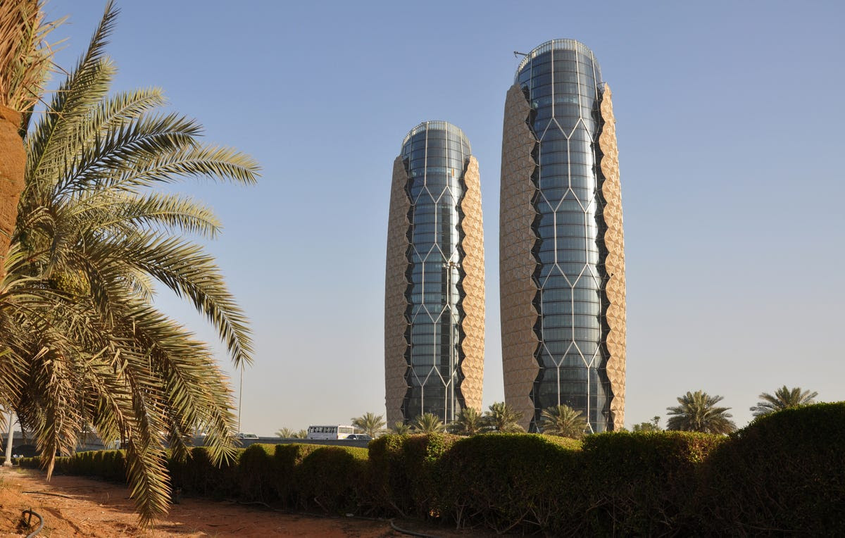 #2 AL BAHR TOWERS — Abu Dhabi's Al Bahr Towers has photovoltaic panels that react to sunlight. As the sun moves, 2,000 umbrellas open and close to reduce interior thermal energy by 50 percent.