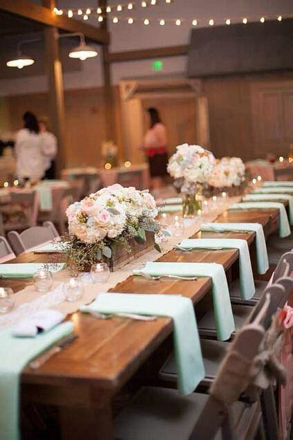 Peach and mint green wedding decor. Farm tables and wood