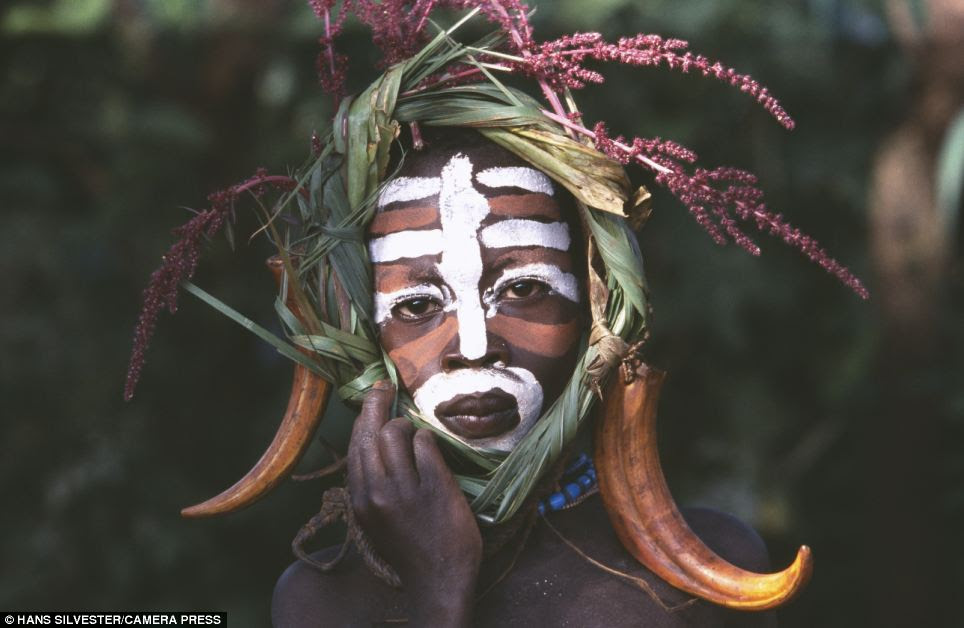 Intricate: Some of the tribes people decorate their faces and bodies with coloured clay as often as three times a day