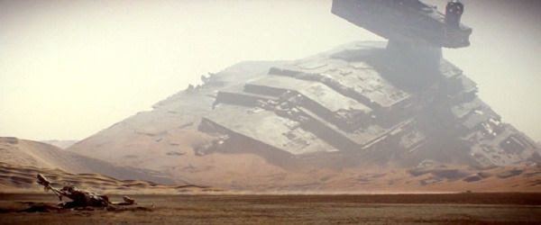 With a crashed Star Destroyer in the distance and the wreckage of an X-Wing fighter in the foreground, Rey's landspeeder (lower-right) zooms across the desert landscape of Jakku in STAR WARS: THE FORCE AWAKENS.