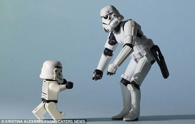 An unlikely moment as a Stormtrooper shares a tender loving moment with his son as the youngster runs into his arms