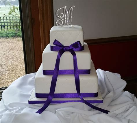 3 tier square wedding cake, quilted effect on top and