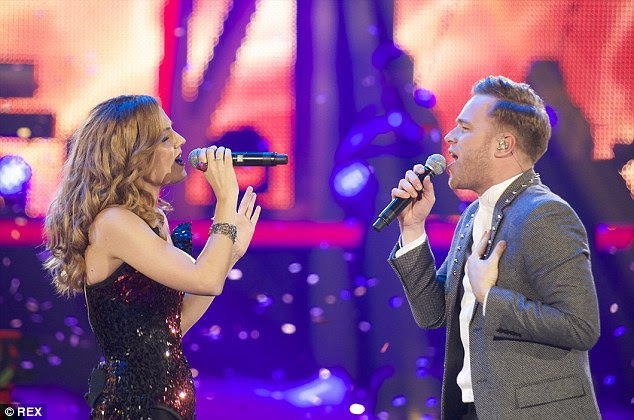 Edurne (left) sang with Olly Murs at thethe 40 Principales Awards in 2013 held in Madrid