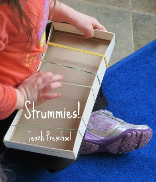 """super easy DIY musical instrument for toddlers - use rubber bands and a box lid to make a fun """"guitar"""""""