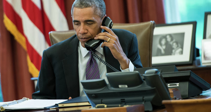 US President Barack Obama speaks on the phone in the Oval Office of the White House