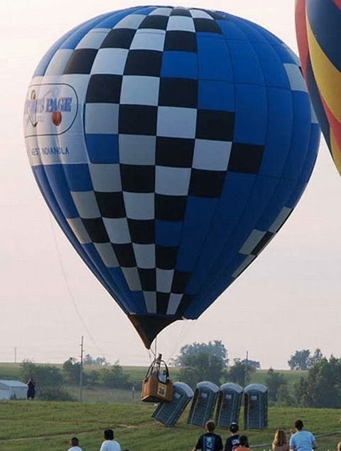 Hot air balloon hits porta loos