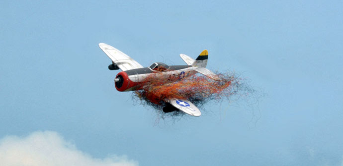A P-47 goes down in flames.