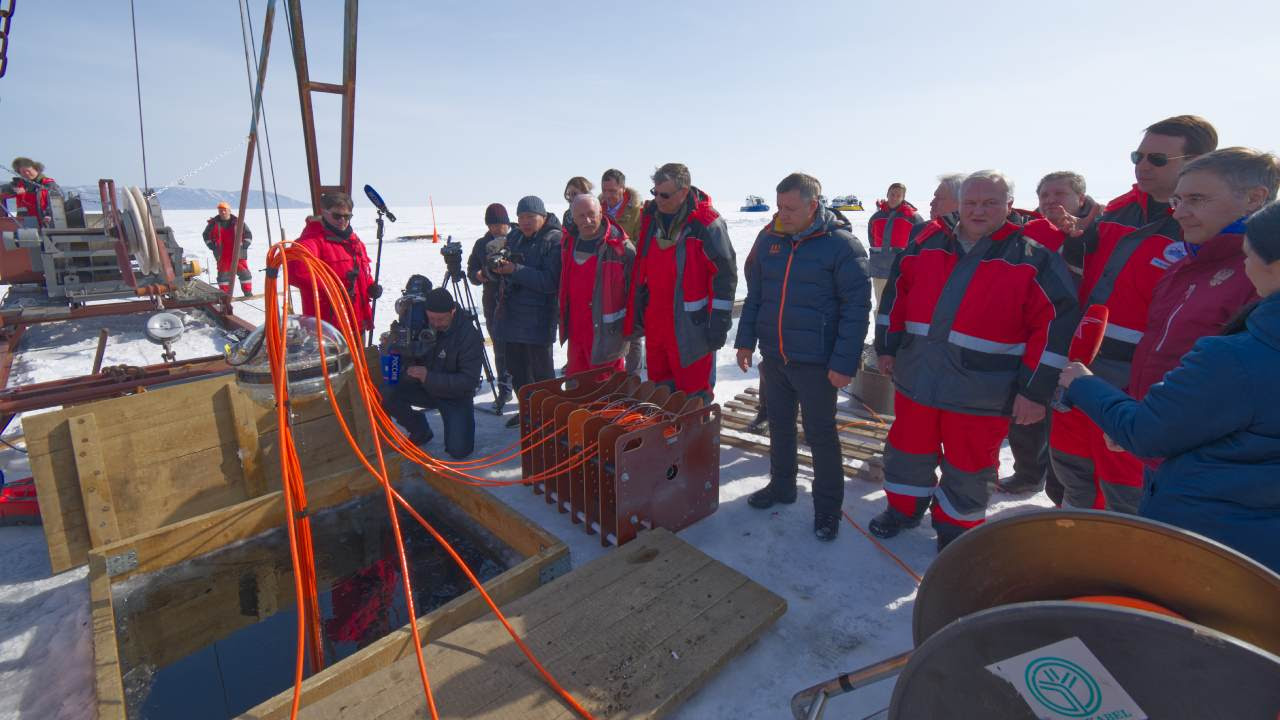 On Saturday, scientists observed the modules being carefully lowered into the freezing waters through a rectangular hole in the ice. Image credit: Joint Institute for nuclear researcher