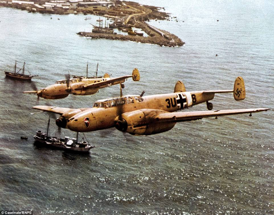 TwoMesserschmitt Bf 110 heavy fighters are pictured over the coast of Sicily in 1942. This image is one of 400 brought together for a new book documenting the rise and fall of the Luftwaffe