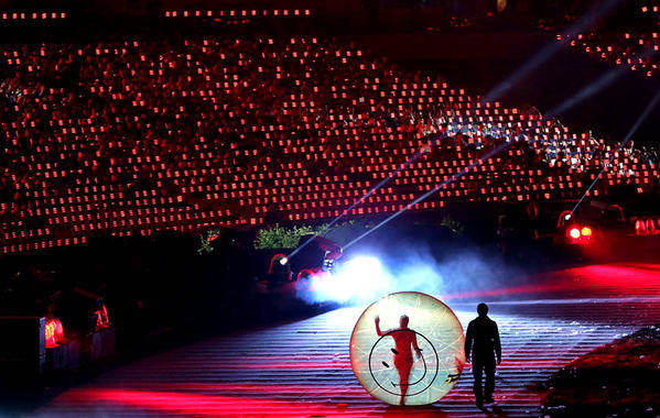 A performer is encased in a translucent ball during the opening ceremonies.