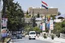 Syrians vote for new parliament amid war, economic turmoil
