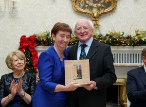 President Michael D. Higgins presenting Sr Mary Sweeney with her Presidential Distinguished Service award in the Peace, Reconciliation category at Áras an Uachtaráin. Pic: MaxwellPhotography.ie