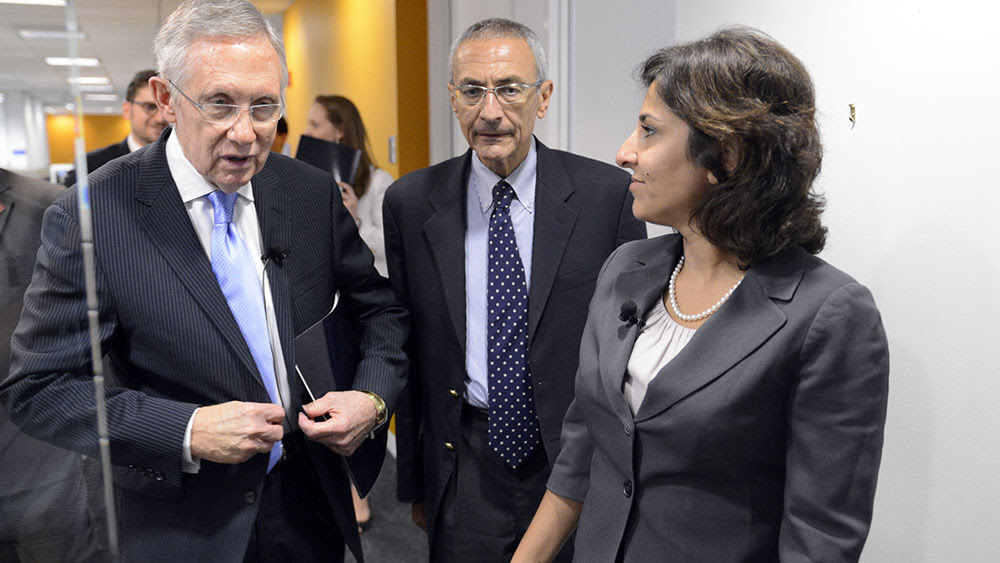 John Podesta, center, and Neera Tanden, right, walk with Senate Minority Leader Harry Reid on Capitol Hill on July 15, 2013. (Tom Williams/CQ Roll Call/Newscom)
