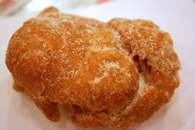 Some dough fritter coated with sugar