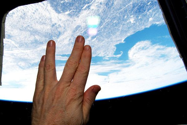 In honor of the late Leonard Nimoy, astronaut Terry Virts does the Vulcan hand salute inside the Cupola aboard the International Space Station...on February 27, 2015.