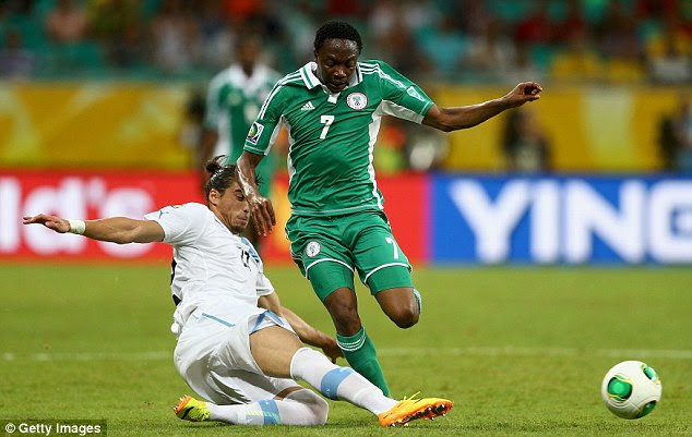 Stuck in: Martin Caceres of Uruguay challenges Ahmed Musa