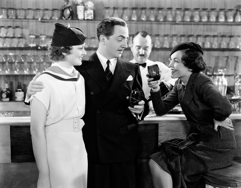 9th May 1934: Myrna Loy (1905 - 1993) and William Powell (1892 - 1984) play sleuthing couple Nick and Nora Charles in 'The Thin Man', directed by W S Van Dyke. Maureen O'Sullivan (1911 - 1998, right) joins them in their hard-drinking crime-solving capers.