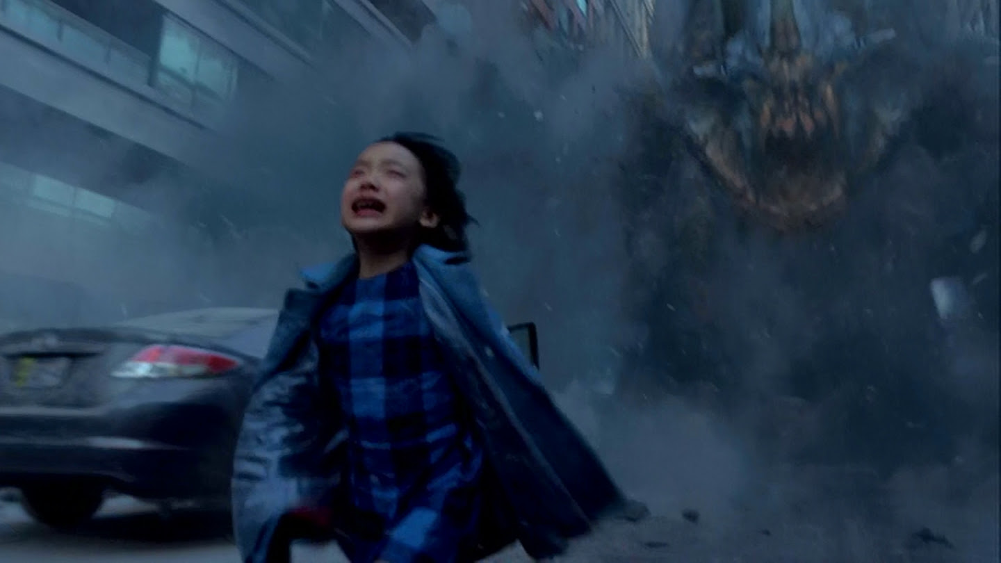 Young Mako Mori runs from the terrifying monster.