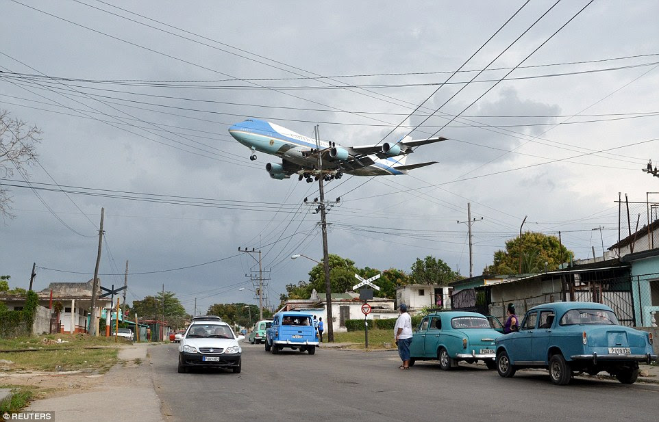 Air Force One broke through the gray crowds as it came into land in Havana, soaring over streets filled with cars dating back decades