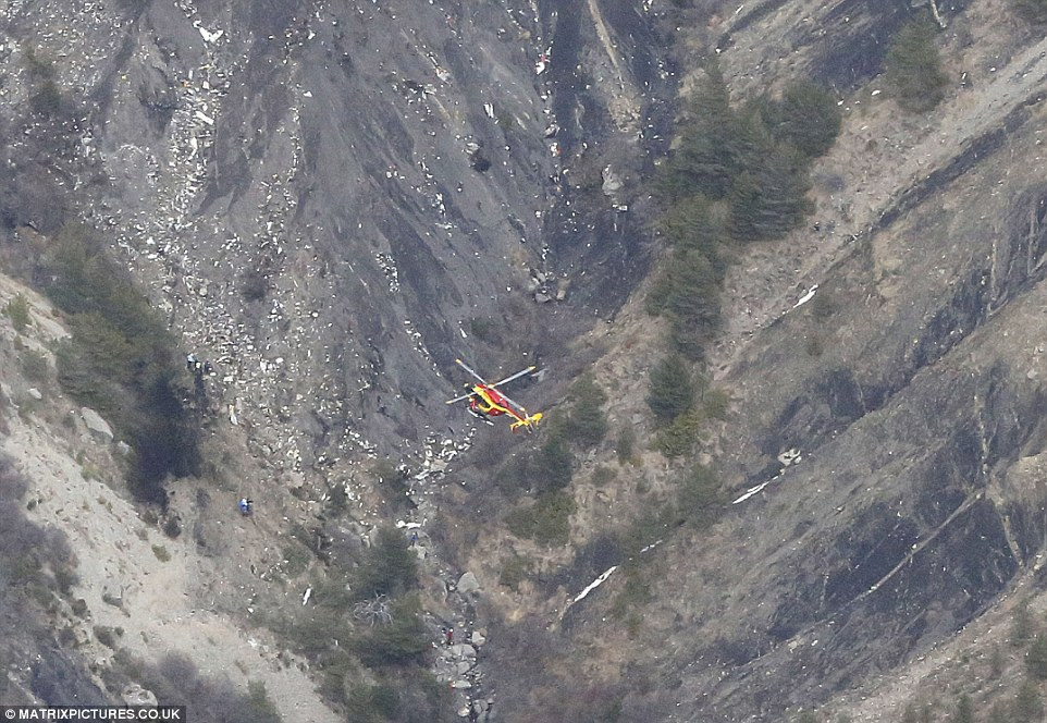 Disaster: A rescue helicopter flies over wreckage of a Germanwings Airbus A320 plane that crashed between the towns of Barcelonnette and Digne in the French Alps. All 150 people on board - including two babies and 16 children from the same German school - are presumed dead
