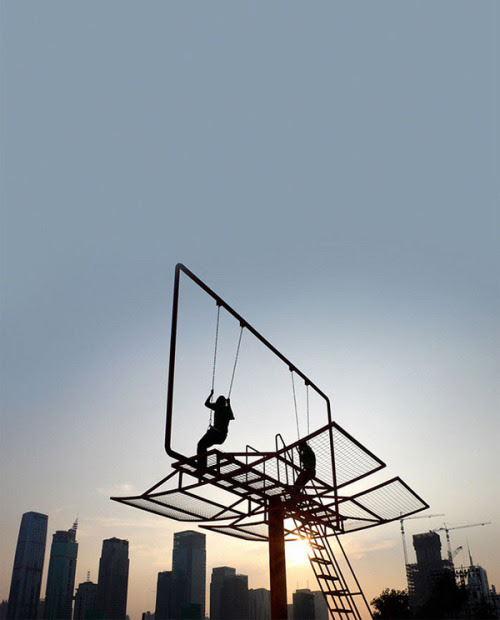 "ReCraft Your Billbord: Double Happiness by Architect Didier Faustino Architect Didier Faustino created this epic swing set out of a converted advertising billboard for the Shenzhen-Hong Kong Bi-City Biennial of Urbanism and Architecture. Double Happiness responds to the society of materialism where individual desires seem to be prevailing over all. This nomad piece of urban furniture allows the reactivation of different public spaces and enables inhabitants to reappropriate fragments of their city. They will both escape and dominate public space through a game of equilibrium and desequilibrium. By playing this ""risky"" game, and testing their own limits, two persons can experience together a new perception of space and recover an awareness of the physical world—————————————————————————————————Displayed on Recraft 