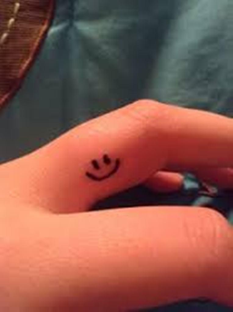 16 Wonderful Smile Finger Tattoo