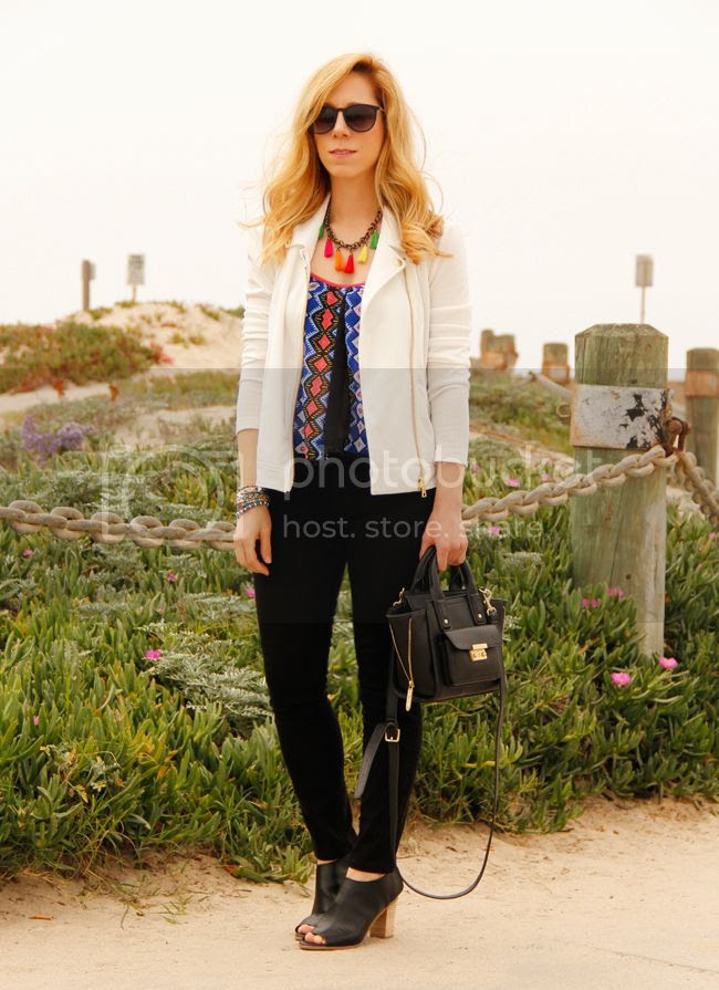 LA fashion blogger The Key To Chic wears a Peter Som for Kohl's moto jacket, Xhilaration world print tribal top, J Brand Jeans, and Mossimo Kacie boots