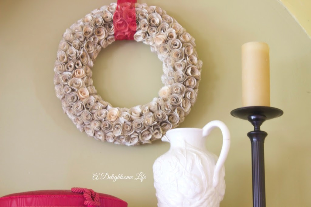 A DELIGHTSOME LIFE book page rose wreath with white pitcher and candle