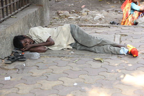 he is waiting for someone to die so he can get a bed .. outside bhabha hospital bandra by firoze shakir photographerno1