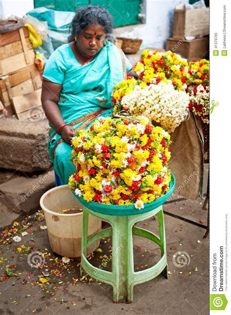 Indian Women Selling Colorful Flower Garland At Street