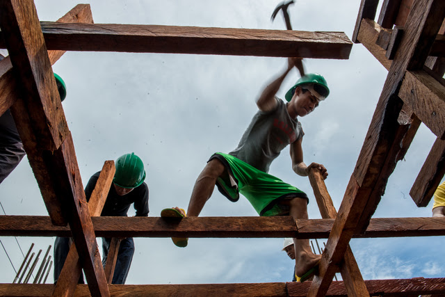 REBUILDING. Carpenters build new classrooms at the Bislig Elementary School in Tanauan, Leyte. Photo by Ariel Javellana/ADB