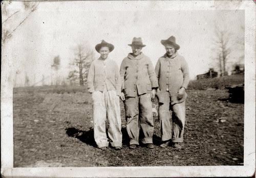 Three men in field