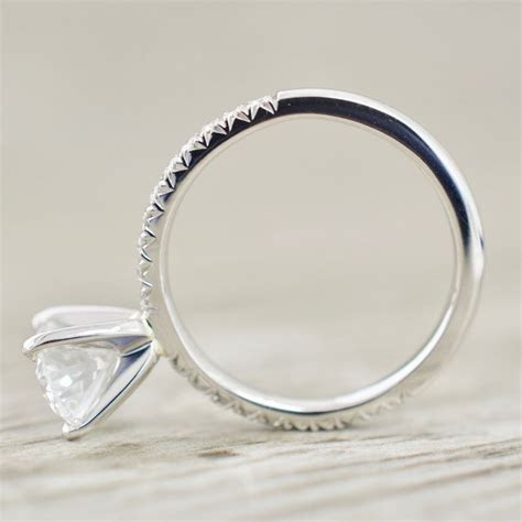 Oval Brilliant Flush Set in a French Pavé Engagement Ring