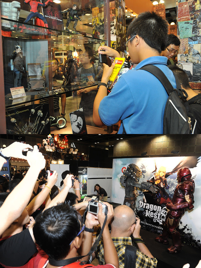 A Hot Toys fans snapping photos of exhibits at the Hot Toys booth + iron man vs predators