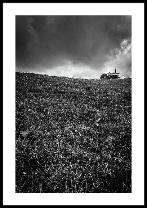 Framed Print of Tractor Silhouetted in Black and White