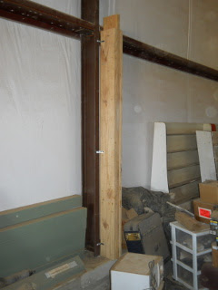 Barn Loft Post on Barn Footer Attached to Metal Post