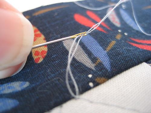 Self-threading needle tute