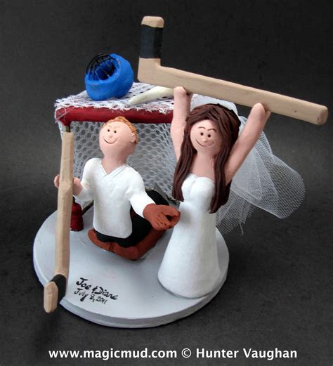 Hockey Bride scores on Goalie Groom Wedding Cake Topper