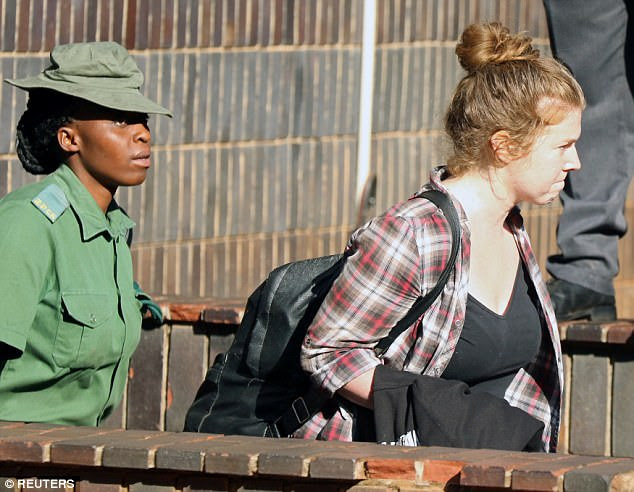 O'Donovan, 25, was remanded in custody after a brief hearing on Saturday morning. She is pictured being taken away from Harare Magistrates Court afterwards