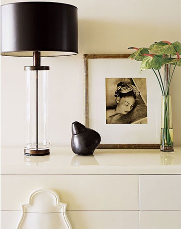 bedrooms - lamp dresser art vase white black silver  House Beautiful   Beautiful vignette of glossy white lacquer chest, glass column lamp with