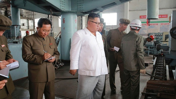 """In this undated photo provided on Tuesday, July 17, 2018, by the North Korean government, North Korean leader Kim Jong Un, center, visits a shipyard in North Hamgyong Province, North Korea. State media say that Kim has harshly reprimanded local officials over a delayed construction project. Independent journalists were not given access to cover the event depicted in this image distributed by the North Korean government. The content of this imag   e is as provided and cannot be independently verified. Korean language watermark on image as provided by source reads: """"KCNA"""" which is the abbreviation for Korean Central News Agency. (Korean Central News Agency/Korea News Service via AP)"""