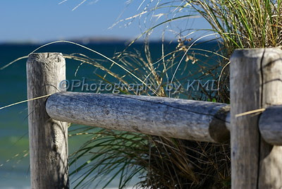 fence post beside the ocean