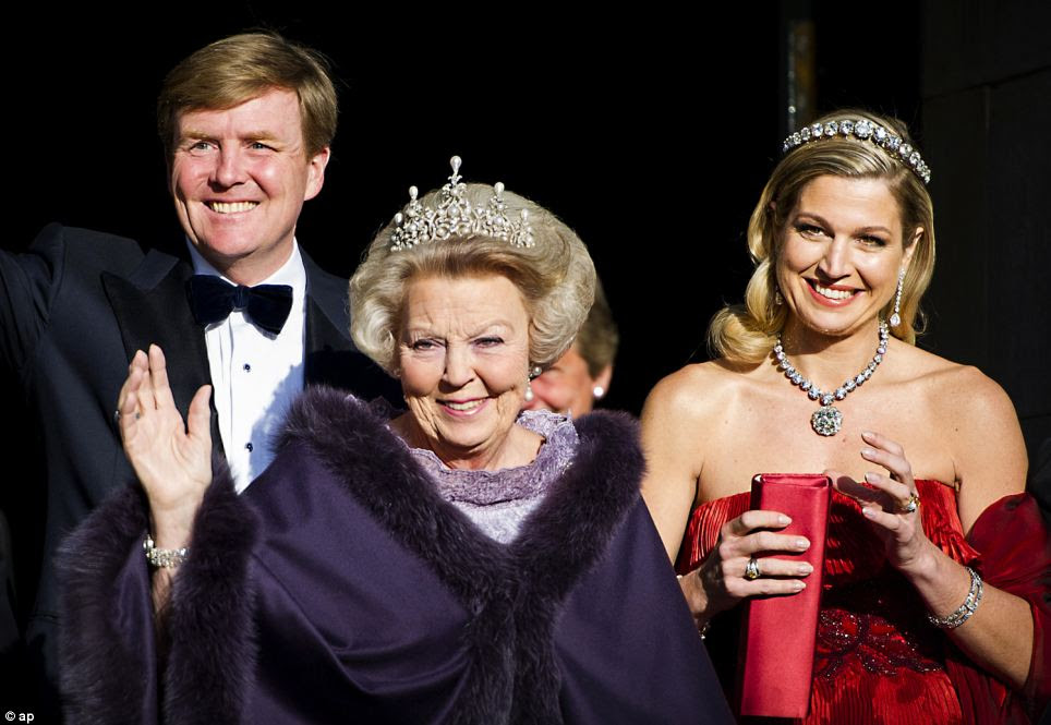 Change over: Dutch Queen Beatrix, centre, and Dutch Crown Prince Willem-Alexander, left, and his wife Princess Maxima arrive for the banquet