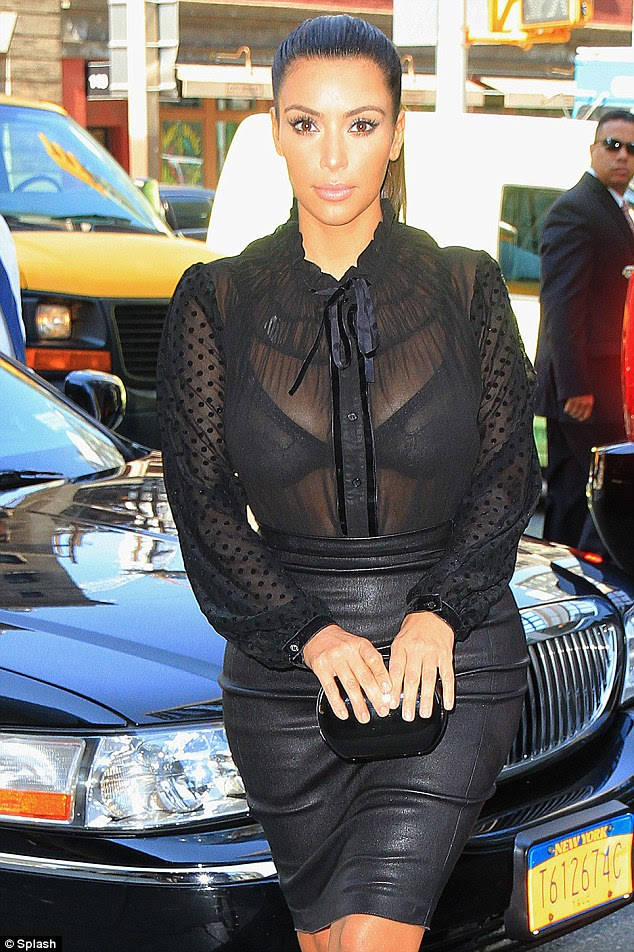 Racy: Yesterday Kim stepped out baring her sheer bra through an even more transparent blouse