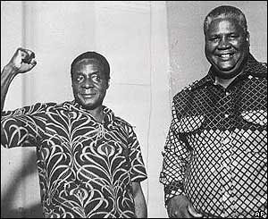 Robert Mugabe of the Zimbabwe African National Union along with Joshua Nkomo of the Zimbabwe African People's Union. Both organization fought for the national liberation of Zimbabwe during the 1960s and 1970s. by Pan-African News Wire File Photos