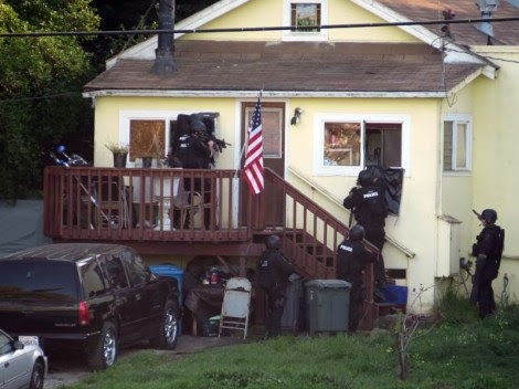 SWAT team engaging the house. Photo Courtesy of Ski-Epic
